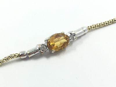 2912bb404698 Pulsera de oro con circonitas y piedra de color