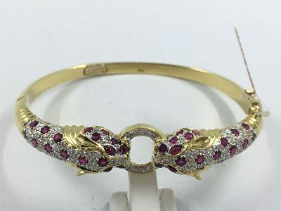 f5af09165063 Pulsera esclava Cartier en oro con brillantes y rubíes