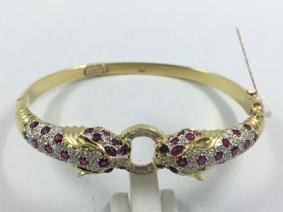 19470942e855 Agotado Pulsera esclava Cartier en oro con brillantes y rubíes